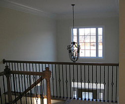 Two-story foyer is easily converted to second floor living space.