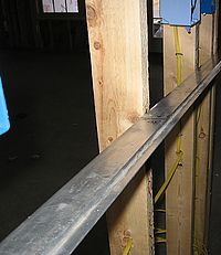 Straight-edge used to ensure that wall is straight before wallboard installed.