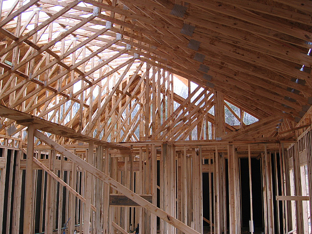 These manufactured trusses provide an instant vaulted ceiling.