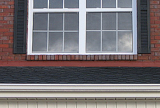 Aluminum flashing under window is painted