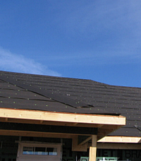 Roofing felt applied by framer, ready for shingles.