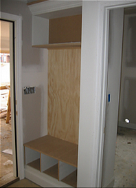hand-built coat and shoe nook
